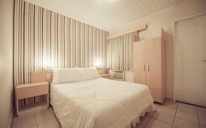 Cama do Hotel Treviso